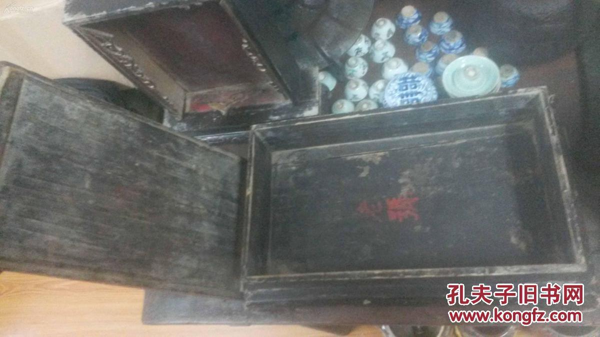 盒子,盖子上可放茶果,箱子里可放备用品,造型独特,大气,摆放很有古意.图片