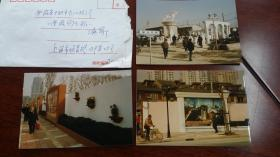 1998上海摄影家蒋振雄拍摄的《上海地铁二号线工地》《复兴东路金牛广场》等上海街景照片三种。背面带签名说明,带投稿信封