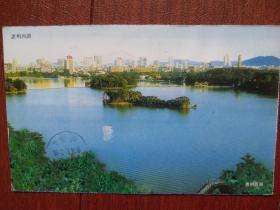实寄明信片,2004珠海机盖邮戳、落地戳清晰,60分牡丹邮资片(英文二版),背面惠州西湖,单张