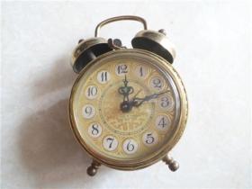 铜雕花北极星闹钟