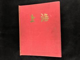 上海1949-1959;五九年八开精装布面画集,上海当时景物时事事件艺术,彩色画面多为贴页式装帧,更有娟面彩印贴页!!!