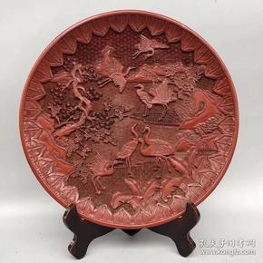 大清乾隆年制底款,剔红漆器松鹤延年赏盘一个,直径约35厘米、