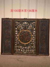 楠木雕刻,镂空福字中堂一套,两侧对联为:四海财源通宝地,九州鸿福进福门。高1米,宽136cm。