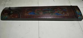 漆器古筝一台,底部有铭文,尺寸160cm*36cm,品好,可弹奏