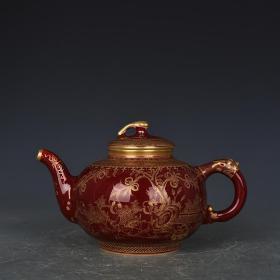 清康熙年制霁红釉描金婴戏纹壶
