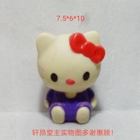 Rubber toys: a petite white cat in purple