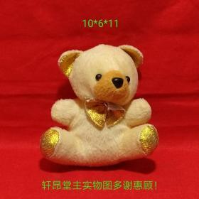 Plush toys: cool little yellow bears with golden ears, golden claws and golden bow ties
