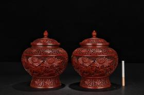 [Late Qing dynasty, a pair of watermelon cans with a rich flower blooming in red lacquerware]