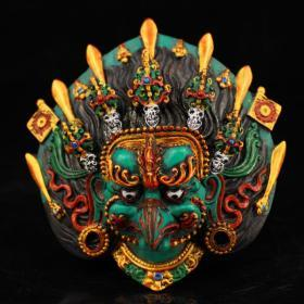Nepal's hand-painted painted lacquer gilt head of the golden eagle god can be hung on the wall to ward off evil
