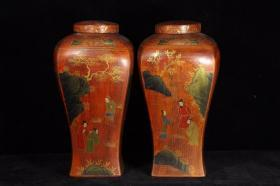 A pair of hand-painted gold character pots with precious lacquerware and wooden tires