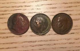 Three British copper coins, Edward VII, George V and George VI