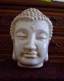 佛头像,,白瓷纹裂。