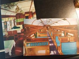 新中国成立时期火车内部餐车及儿童车厢明信片两张