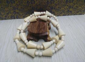 古玩文玩收藏类:欧洲回流猛犸牙项链 展开总张53cm左右 重47.6g左右 欧洲工艺 做工精湛 材料保真 实物图片