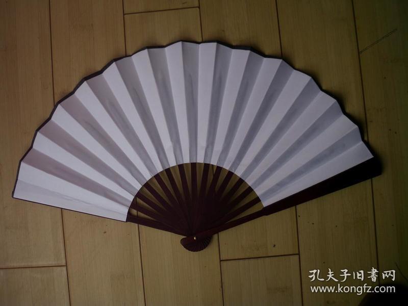 竹柄云錦素面折扇。