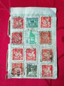 23枚盖销老邮票,粘贴在一张纸的正面和背面