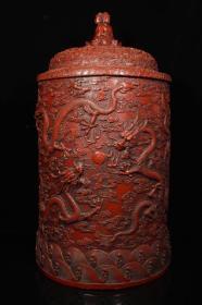 剔红漆器佛经桶,桶身刻八条盘龙,盖子三面佛,尺寸高48厘米,直径24厘米