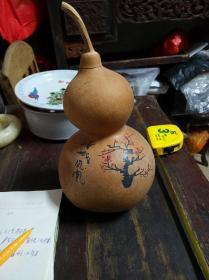 画有梅花的老葫芦一个,葫芦是道教八宝之一
