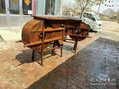 风谷车(又称风车):我国农业种植中用来去除水稻等农作物子实中杂质、瘪粒、秸杆屑等的木制传统农具