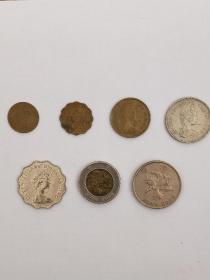 香港硬币(一套七枚)。1亳1982年币、2毫1978年币、5亳1977年币,一元1978年币,两元1981年币,五元1993年币,十元1995年币。共七枚全是九七年回归以前港币。