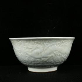 明宣德卵白釉雕刻龍穿花內畫青花蓮池鴛鴦紋碗 高10.5厘米 口徑21.5厘米