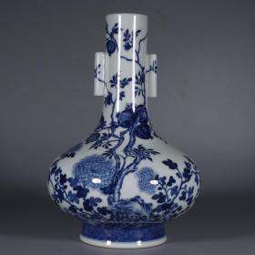大清雍正年制款 青花牡丹石榴纹贯耳扁肚瓶。