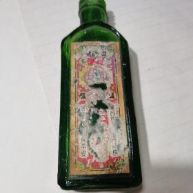 民国 百信行药业公司南洋星加坡真龙正红花油玻璃瓶包老   少见品种
