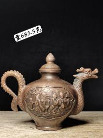 雕刻八仙过海龙头铜壶。