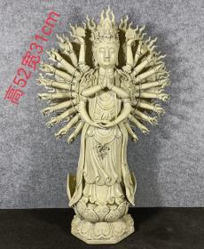 """明代德化窑""""何朝宗""""款白瓷挂釉千手观音,胎质细腻,施釉均匀饱满,保存完好,成色如图。"""