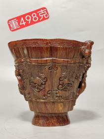 乾隆年制款,瑞兽牛角杯,雕工精美。