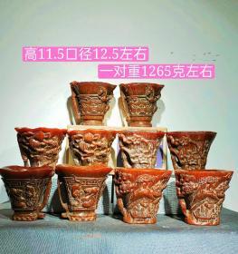 牛角杯五对,雕工精美,包浆浓厚,鱼子纹清晰可见,保存完整,磨损自然,品相如图!标的是一对的价钱
