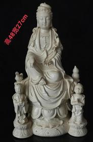 """明代德化窑""""何朝宗""""款白瓷挂釉'童子观音',胎质细腻,施釉均匀饱满,保存完好,成色如图。"""