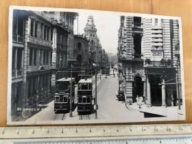 民国早期香港中环德辅道,街头的双层巴士、英皇大酒店、山打洋行原版老照片