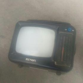 中国第一批手提小电视(按电池,用电二用)带充电器,按上电,很清晰
