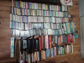 磁带,VCD ,DVD,录像带一堆,打包出售(6元包邮普包,18元包快递),其中磁带约280个,VCD,DVD约300张【磁带和唱片类】.【只发快递或普包】......