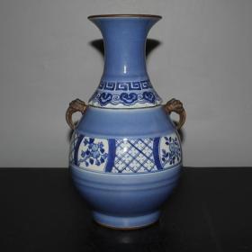 蓝釉青花四季花卉双耳瓶  高26.3厘米,口直径9.2厘米,底直径9.1厘米.