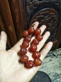 老玛瑙瓜楞串。南瓜珠,13颗,1.7~1.8的珠子,老珠包浆一流,玛瑙通透红润,品相超一流,不可多得。