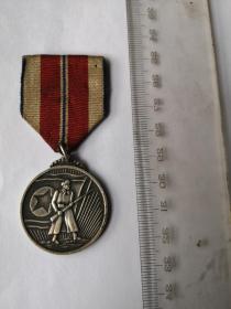 抗美援朝纪念章,应该是银的吧,品像好