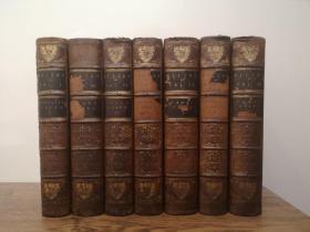 1851 The Works of John Milton 《弥尔顿作品集》,七卷(全套八卷),缺第二卷。装帧豪华精美,全小牛皮精装,三面书口大理石纹。这套书原是剑桥大学最古老的三一学院的奖励品,封面和封底都有烫金的院徽和院训。开本22.5cmX15.5cm,七大厚本。