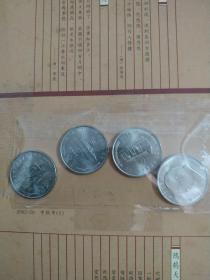 中国共产党成立七十周年纪念币一套3枚、毛泽东诞辰100周年纪念币1枚。
