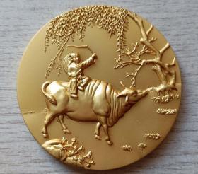 2009年中国投资担保有限公司生肖(牧童归来-牛)镀金纪念章