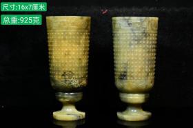 出土新疆和田玉籽料高足杯一对,玉质油润透亮,吊雕刻精细,品相完美,土沁自然