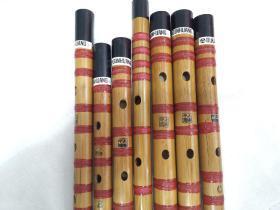 """上海民族乐器一厂""""敦煌""""牌竹笛,上世纪生产的手工精品库存笛子,完好无瑕疵,做工精美用料扎实,不可多得的乐器精品。扎线笛有bE,F,G,A等调。标价为单支的价格。"""