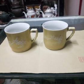 五六十年代黄釉堆白花鸟茶杯一对