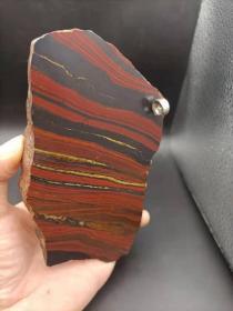"""陨石原石,""""南丹炫彩""""陨石原石切片,稀有""""极品炫彩""""陨石切片,半斤多重,质量比重大,沉甸甸的,气印、气孔、熔壳包浆完整,非常特别,石质细腻坚硬,色泽油润,石型完整,气印熔流明显,极为稀有罕见,沁色自然,鬼斧神工,收藏之极品"""
