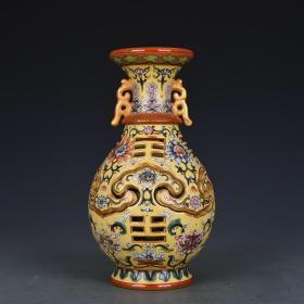 清乾隆黄地珐琅彩轧道花卉纹交泰瓶转心瓶