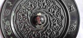 """稀少黑漆古""""五月五日午时""""花卉铜镜。,农历五月为午月,午月午日,即为端午,又称重午。"""