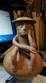 收藏级远古陶器:奇特人型古陶罐:一眼真