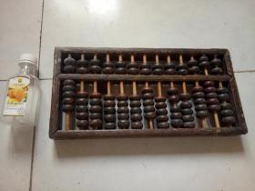 一个花梨木框架紫檀珠老算盘(保存完好,包浆厚重)