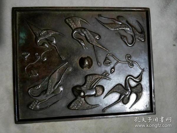 铜镜子长方,中心直径18公分.---.-.,-